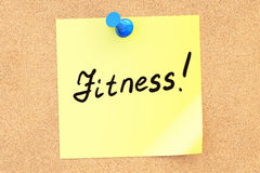 Fitness text on a sticky note pinned to a corkboard. 3D renderin Stock Photo