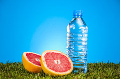 Fitness theme with fruits, blue background Stock Photography