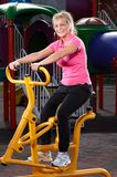 Fitness time. Girl exercising on stepper machine Stock Images