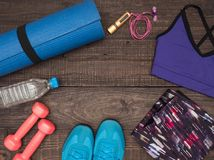 Fitness time, everything is ready for a good workout. Time fitness-form, shoes, music player, water bottle, rug and dumbbells. Ahead of class training Stock Photography