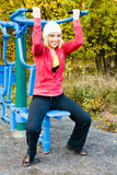 Fitness Time At Outdoors. Young woman during fitness outdoor stock photography