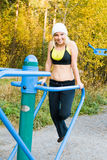 Fitness Time At Outdoors. Young woman during fitness outdoor stock images