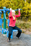 Fitness Time At Outdoors. Young nice blond woman during fitness outdoor stock image