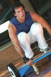 Fitness & Tired Men With Yoke. Exercise of a men in training with the balance / Looking Ahead / Above the Step Royalty Free Stock Photography