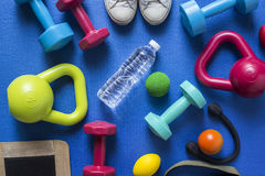Fitness tools on blue yoga mat background Royalty Free Stock Image