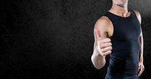 Fitness Torso wearing a black shirt against neutral black background Stock Photography