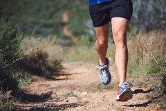 Fitness trail man. Trail running man exercising outdoors for fitness Royalty Free Stock Image