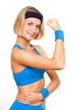 Fitness trainer. Picture of a beautiful blond girl Stock Photography
