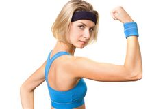 Fitness trainer. Blond girl with a blue wristband Stock Images