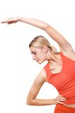 Fitness trainer. Picture of a girl showing a fitness exercise Royalty Free Stock Images