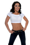 Fitness Trainer. Young female personal fitness trainer in designer jeans and a half t-shirt with her hands on her hips Stock Photography