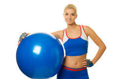 Fitness trainer with a ball Royalty Free Stock Photography