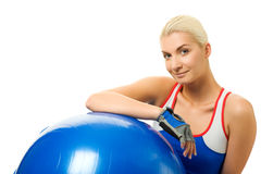Fitness trainer with a ball Stock Images