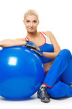 Fitness trainer with a ball Royalty Free Stock Photo