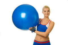 Fitness trainer with a ball Royalty Free Stock Image