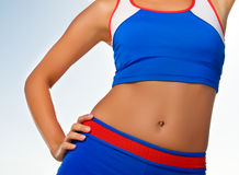 Fitness trainer body fragment Stock Photo