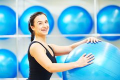 Fitness trainer or coach woman with excarcise ball Stock Images