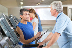 Fitness trainer coaching elderly Royalty Free Stock Photo