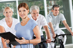 Fitness trainer coaching spinning Royalty Free Stock Image