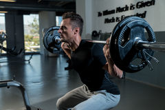 Fitness Trainer Doing Squats With Barbells Royalty Free Stock Photos