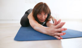 Fitness trainer doing yoga at gym Royalty Free Stock Image