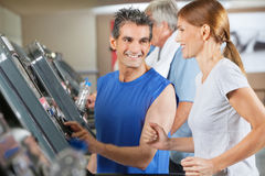 Fitness trainer explaining. Treadmill to jogging women in gym Stock Photo