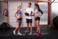 Fitness Trainer explaining exercise Stock Photography