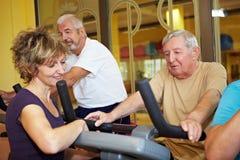 Fitness trainer explaining spinning Royalty Free Stock Photos