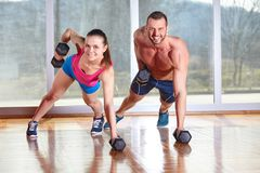 Fitness. Trainer explaining treadmill to jogging women in gym Royalty Free Stock Photos