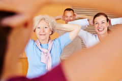 Fitness trainer giving senior. Fitness class in a health club Royalty Free Stock Images