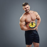 Fitness trainer  on grey background. Handsome guy fitness trainer  on grey background Stock Images