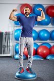 Fitness trainer in the gym. Fitness male trainer in the gym with equipment in background Royalty Free Stock Images