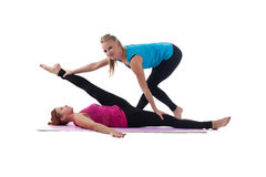 Fitness trainer help woman exercise stretch Royalty Free Stock Images