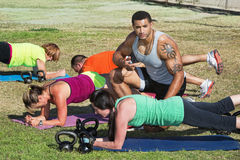 Fitness Trainer Helping Students Stock Photo