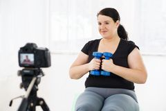 Overweight blogger recording content for vlog. Fitness trainer, internet sporting class, training online video course. overweight blogger recording content for stock photography