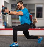 Fitness trainer with medicine ball Royalty Free Stock Photography