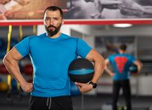 Fitness trainer with medicine ball Stock Photos