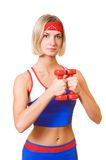 Fitness trainer with red dumbbells Stock Photography