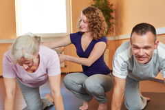 Fitness trainer with senior sports. Group giving instructions to elderly woman Royalty Free Stock Photography