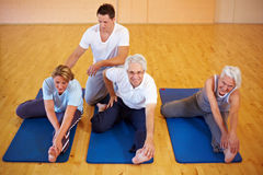 Fitness trainer showing stretching Stock Image