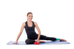 Fitness trainer sitting on mat with dumbbells Stock Photography