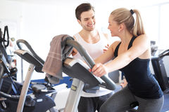 Fitness Trainer Talking to a Woman Inside the Gym Stock Images