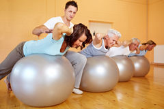 Fitness trainer teaching back Royalty Free Stock Image