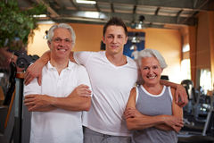 Fitness trainer and two seniors Royalty Free Stock Photos