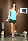 Fitness trainer using gym machine Royalty Free Stock Image