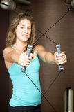 Fitness trainer using gym machine Royalty Free Stock Photography
