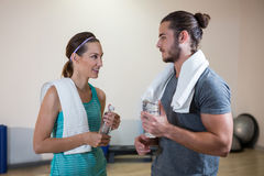 Fitness trainer and woman holding water bottle Royalty Free Stock Photography