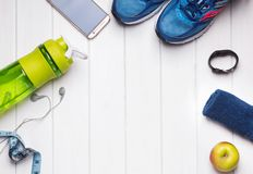 Fitness training accessories on the white table Royalty Free Stock Photography