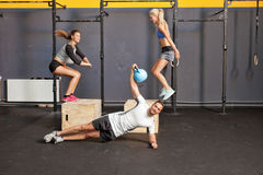 Fitness training - box jump and kettlebell training Stock Photos