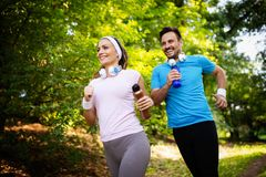 Fitness training for couple in love outside stock photography